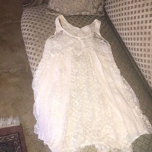 Free people cream raw Handkerchief bottom dress